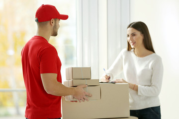 Young woman and delivery man