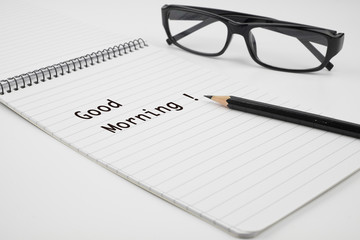 Good Morning is written on notepad