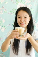 Young asian woman drinking hot coffee in the morning