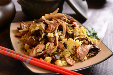 Fried rice with meat, mushrooms and soi
