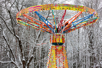 carousel in amusement park under snow
