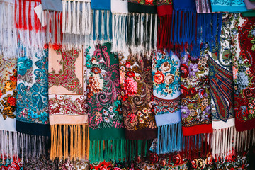 Rows of Russian colorfull scarfs and headscarfs