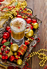 cup of hot coffee or a cappuccino with Christmas decorations