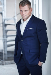 Macho man in blue suit.