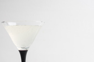 Cocktail in martini glass on the white wooden background