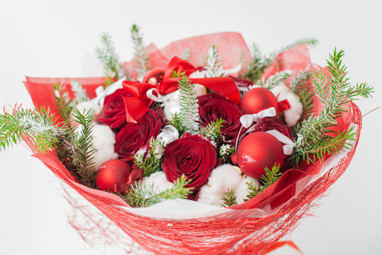 Close-up of Christmas winter bouquet of red rose and cotton in t