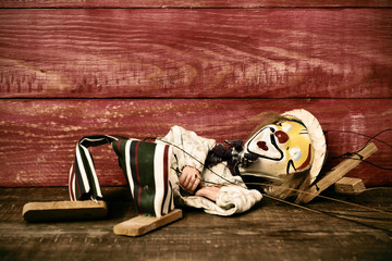 old marionette on a wooden surface, filtered