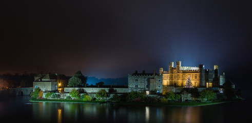 English castle with Christmas lights at night