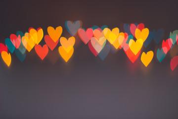 Line of colorful blurred heart shape lights