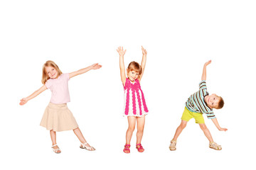 Funny little kids dancing. Isolated on white