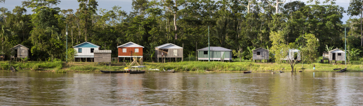 Wooden house on stilts along the Amazon river and rain forest, B