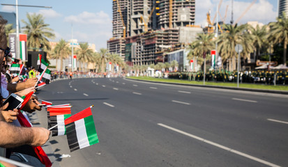 DUBAI, UAE - December 01, 2015: Daytime of 44th UAE National Day celebration parade at the Mohammed Bin Rashid Boulevard, downtown Dubai, taken on December 01, 2015, in Dubai, United Arab Emirates