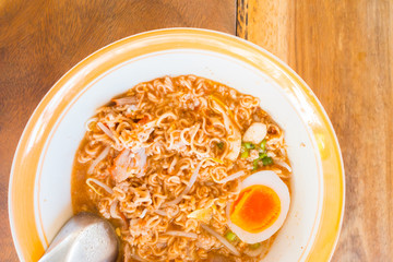 Asian red pork noodle with egg soup