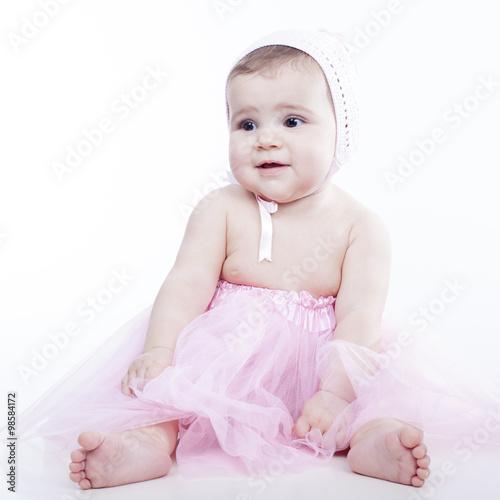 Bebé Con Tutú Rosa Sentada Con Cara De Circunstancias Stock Photo