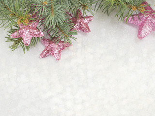 Shiny Christmas background with ornaments and fir tree