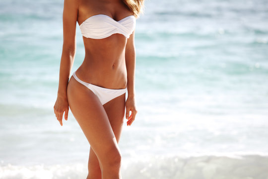 Woman body on beach background