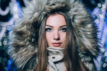 Winter portrait of young beautiful girl. Fashion photo.