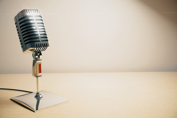 Vintage microphone on white wooden table