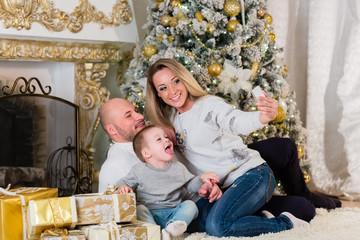 Happy family near Christmas tree.