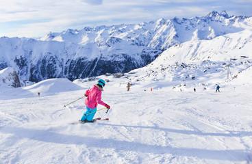 Girl skier in winter resort