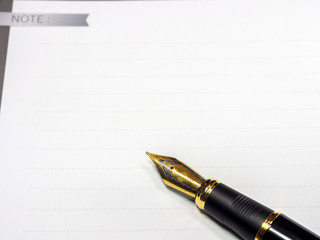 Fountain pen  shot with shallow depth of field on white paper.