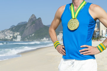 Gold medal athlete standing outdoors on Ipanema Beach in Rio de Janeiro, Brazil