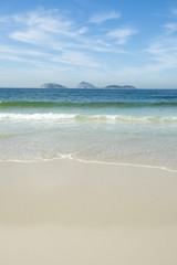 Ipanema Beach Rio de Janeiro Brazil empty morning view with Ilhas Cagarras islands on the horizon