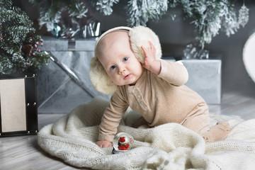 Happy little boy with fur headphones