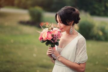 Bride holds boho wedding bouquet