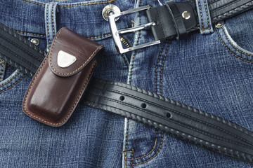 Blue jeans with leather belt and knife case