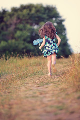 Girl running with a butterfly net, Sinemorets, Bulgaria