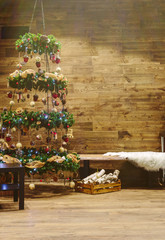 Christmas tree decoration with wooden wall background