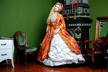 Retro baroque fashion blonde woman wearing gold dress.