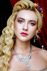 Cloce up portrait of Retro baroque fashion blonde woman wearing dress.
