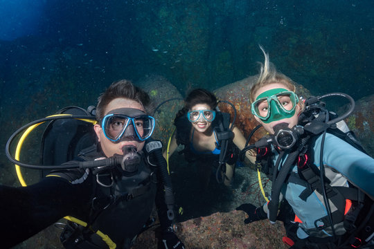 diver making a selfie on corals reef background