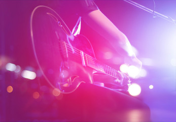 Guitarist on stage for background, soft and blur concept