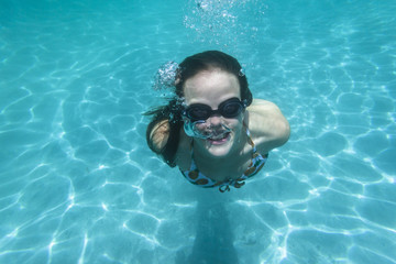 Girl Underwater Swimming pool summer fun happiness expressions