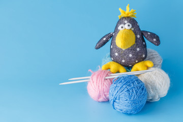 Funny crow with colored wool clew