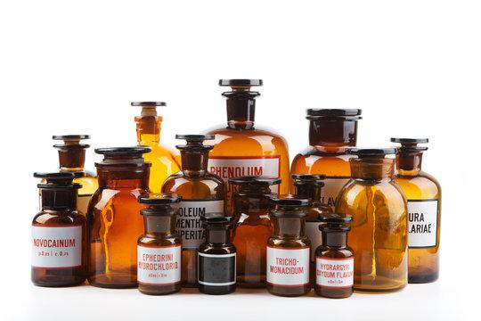 Vintage pharmacy bottles on white background
