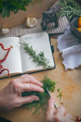 Grandmothers hand cutting herbs