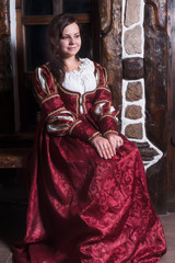 Portrait of elegant woman in medieval era dress