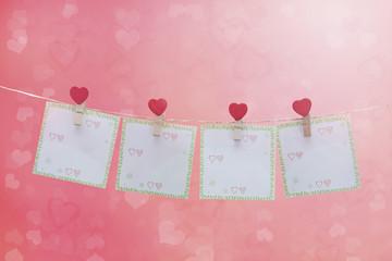 love symbol and hearts hanging on the clothesline