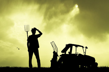 farmer and tractor in the field
