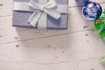 Blue gift box and christmas decoration on wooden background.