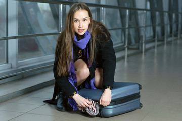 Girl was scattered luggage in transit