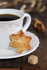 Cup of coffee and christmas sugar cookies