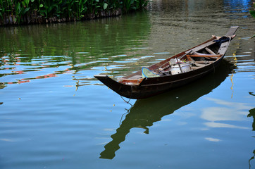 Boat floating in pond at Thung Bua Chom floating market