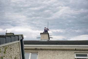chimney sweep busy cleaning chimney