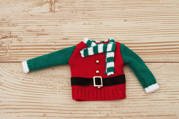 Green and Red Elf Christmas Sweater on a Weather Wood Background