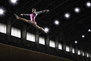 A gymnast with her arms outstretched leaping in the air